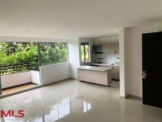 Una cocina con un lavabo y un gran ventanal en Los Cabos