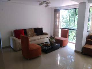 Una sala de estar llena de muebles y una ventana en QUINTAS DEL PALMAR