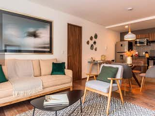 Una sala de estar llena de muebles y una televisión de pantalla plana en Guillermo Prieto 40