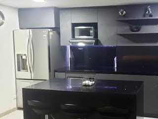 Una cocina con lavabo y microondas en Apartamento en venta en Las Antillas, 69mt con balcon