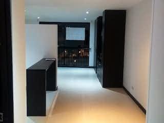 Cocina con nevera y microondas en Apartamento en venta en Chapinero de  1 habitacion