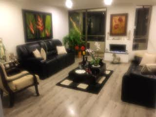 Una sala de estar llena de muebles y una chimenea en Camino del Country