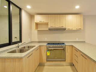 Una cocina con lavabo y microondas en Amores 211