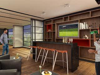 Una sala de estar llena de muebles y una televisión de pantalla plana en KD Essential