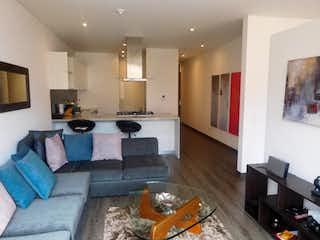 Una sala de estar llena de muebles y una televisión de pantalla plana en Edificio Marancal