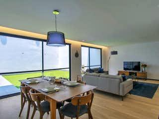 Una sala de estar llena de muebles y una televisión de pantalla plana en Residencial Adolfo Prieto 805