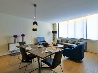 Una sala de estar llena de muebles y una gran ventana en Mitla 390