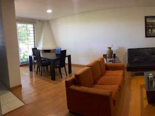 Una sala de estar llena de muebles y una televisión de pantalla plana en Apartamento en venta en Contador, 64mt con balcon