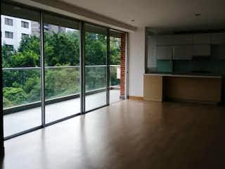 Una vista de una sala de estar desde una ventana en MACCANA