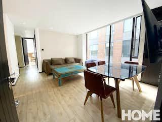 Una sala de estar llena de muebles y una televisión de pantalla plana en Apartamento en venta en La Calleja de 79m2