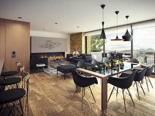 Un grupo de sillas sentadas en una sala de estar en Carrá