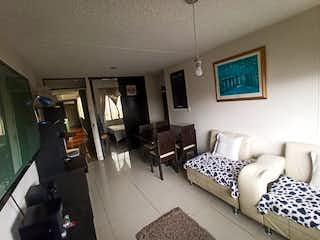 Una sala de estar llena de muebles y una ventana en Apartamento en venta en Bolivia de 3 habitaciones