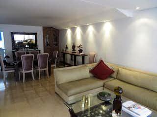 Una sala de estar llena de muebles y una gran ventana en Casa en venta en Castropol  de 4 habitaciones