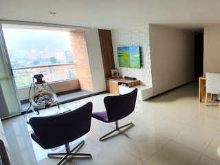 Una habitación llena de muebles y una televisión de pantalla plana en Apartamento en venta La Abadía de dos habitaciones