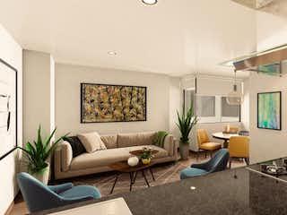 Una sala de estar llena de muebles y una televisión de pantalla plana en Monteverde