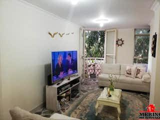 Una sala de estar llena de muebles y una televisión de pantalla plana en IPANEMA