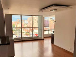 Una vista de una sala de estar desde una ventana en Apartamento en venta en Cedritos de 103m2