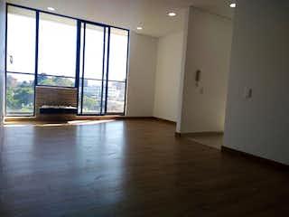 Una sala de estar llena de muebles y una televisión de pantalla plana en Edificio
