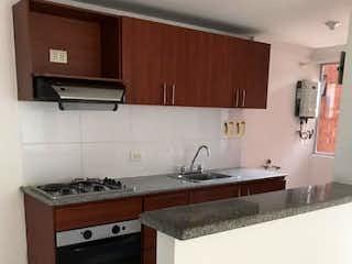 Una cocina con una estufa y un fregadero en Apartamento en venta en Cuarta Brigada de tres alcobas
