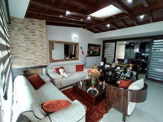 Una sala de estar llena de muebles y una gran ventana en Apartamento en venta en La Granja de 3 habitaciones