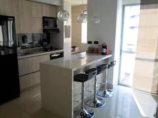 Una cocina con fregadero y nevera en Apartamento en venta en San Germán de tres alcobas