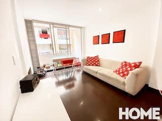 Una sala de estar llena de muebles y una ventana en Apartamento en venta en Bella Suiza de  1 habitacion