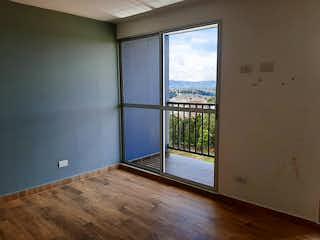 Una vista de una habitación con una puerta corredera de cristal en Apartamento en venta en Fontibón de tres habitaciones