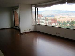 Una vista de una ciudad desde una ventana en Apartamento En Venta En Bogota Provenza