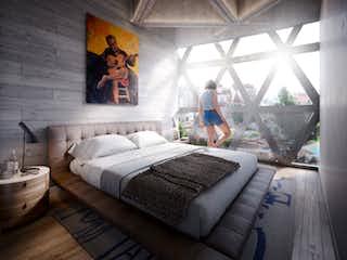 Una persona sentada en una cama en una habitación en Torre Havre