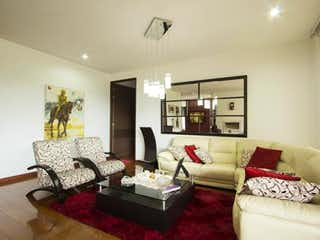 Una sala de estar llena de muebles y una gran ventana en Apartamento en venta en Ciudad Salitre de  3 habitaciones