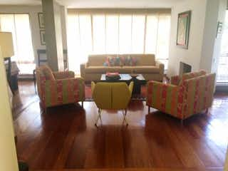 Una sala de estar llena de muebles y una ventana en Edificio Salamanca
