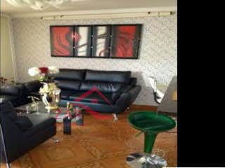 Una sala de estar llena de muebles y una chimenea en Apartamento en venta en Belén Centro, 90mt con balcon