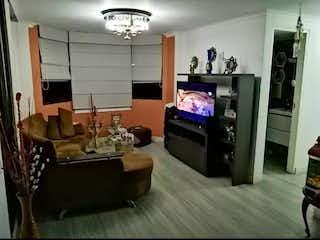 Una sala de estar llena de muebles y una televisión de pantalla plana en portal de calasanz