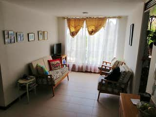 Una sala de estar llena de muebles y una ventana en Apartamento en venta en San Javier, 67mt