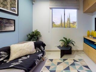 Una sala de estar llena de muebles y una televisión de pantalla plana en Ciudadela Monteflor - Acacias