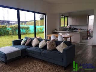 Una sala de estar llena de muebles y una gran ventana en Casa en venta en Acuarela, de 1150mtrs2