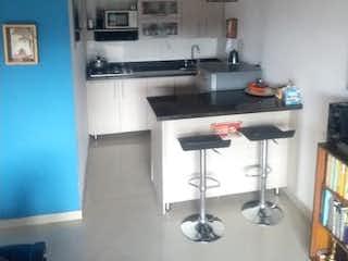 Una cocina que tiene un montón de armarios en ella en Apartamento en venta en Suramérica, 64mt con balcon
