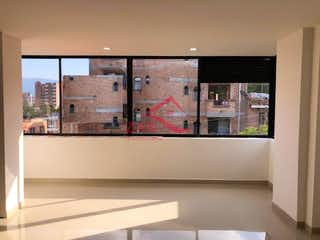 Un cuarto de baño con dos lavabos y un gran espejo en Apartamento en venta en Simón Bolívar de tres habitaciones