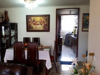 Una sala de estar llena de muebles y una televisión de pantalla plana en PORTAL DEL PARQUE