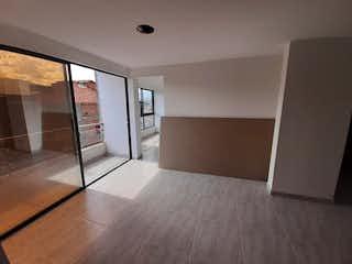 Una vista de una cocina desde el pasillo en Apartamento en venta en Caicedo de tres habitaciones