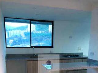 Un cuarto de baño con lavabo y un espejo en Apartamento en venta en Virgen del Carmen, 64mt con balcon