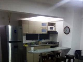 Una vista de una cocina y una cocina en Apartamento en venta en Santa Fé de Antioquia, 73mt con balcon