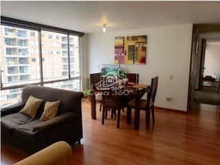 Una sala de estar llena de muebles y una mesa en Apartamento en venta en Pradera Norte, 78mt