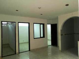 Un cuarto de baño con dos lavabos y una ducha en Casa En Venta En Chia Primavera, cuenta con tres pisos.