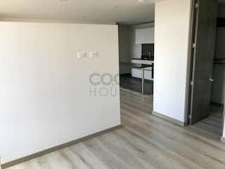 Un refrigerador congelador blanco sentado dentro de una cocina en Apartamento en venta en Chapinero Alto de una habitacion