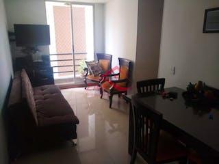 Una sala de estar llena de muebles y una ventana en ACUARELA