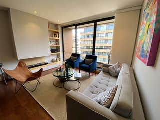 Una sala de estar llena de muebles y una gran ventana en Apartamento en venta en Virrey