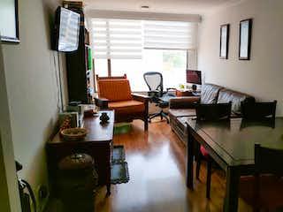 Una sala de estar llena de muebles y una ventana en Apartamento en venta en Contador, 70mt