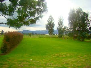 Una vista de un campo herboso con árboles en el fondo en Lote en venta en Fusca, de 1777mtrs2