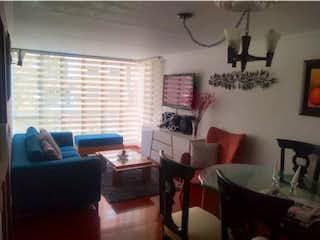 Una sala de estar llena de muebles y una gran ventana en Apartamento en venta en Prado Pinzón, 68mt